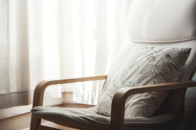 white pillow with leaves print